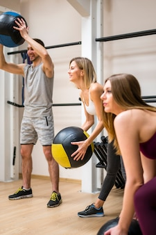 Women working out with trainer