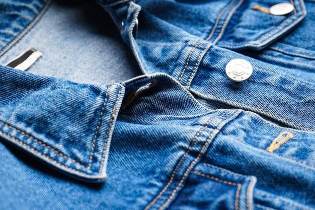 Womens blue jean jacket close-up