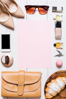 Womens clothes and accessories on a white background