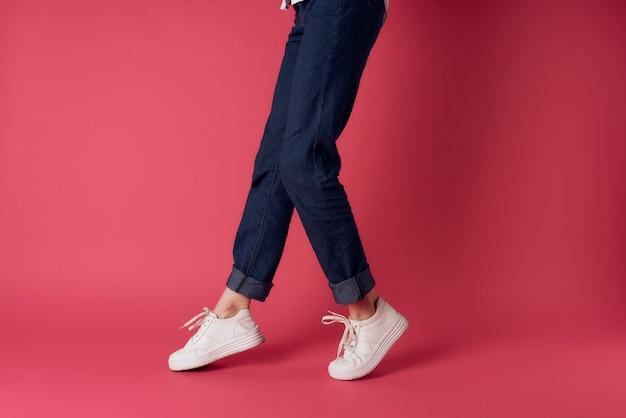 Womens feet wearing white sneakers fashion street style