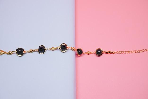 Womens gold bracelet with black diamond