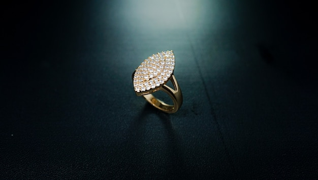 Womens gold ring with square motifs and embellished with small shining diamonds