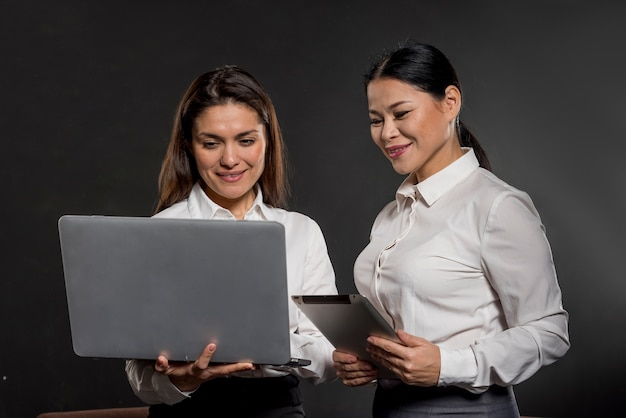 Womens looking on laptop