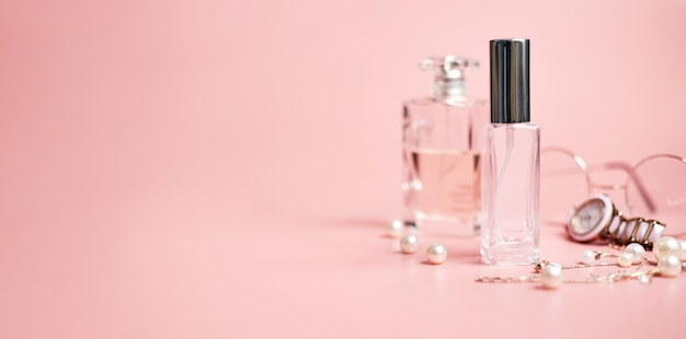 Womens perfume in glass tube, on pink background, copy space, banner. high quality photo