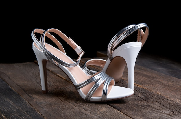 Womens sandals on wooden table