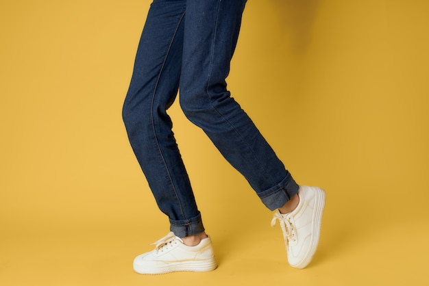 Womens white sneakers fashion modern style yellow background