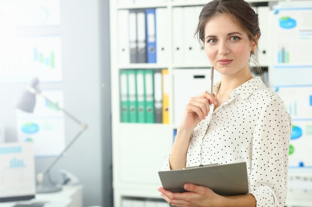 Wonderful cheerful woman in conference room