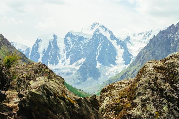 Wonderful glacier on rock background.