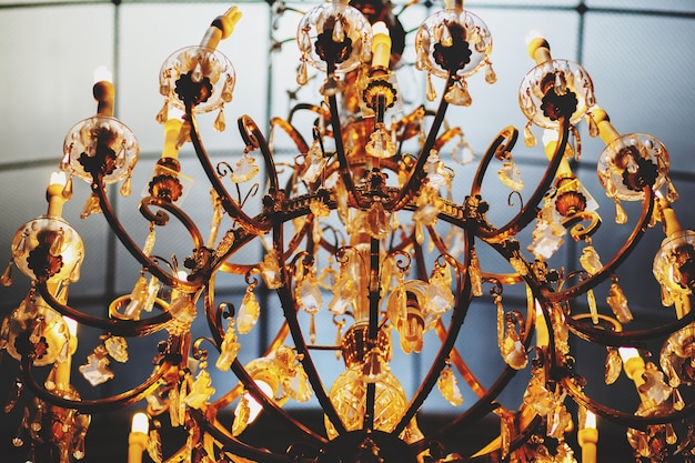 A wonderful old gold vintage chandelier decorated with crystals