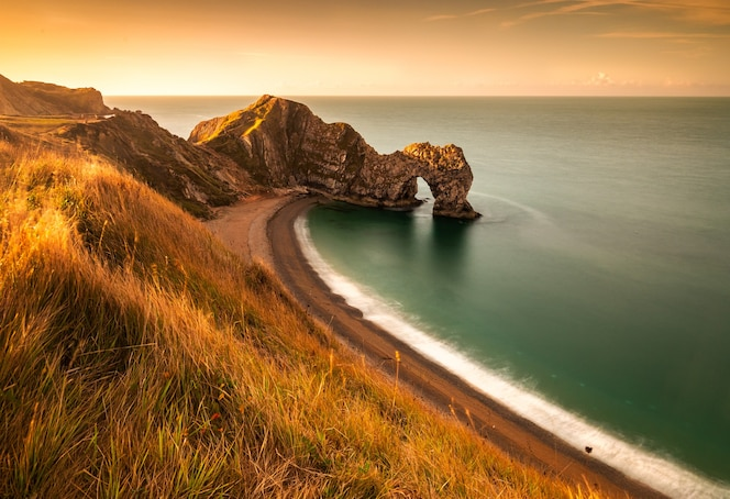 Wonderful sunrise in an august morning at durdle door in dorset england