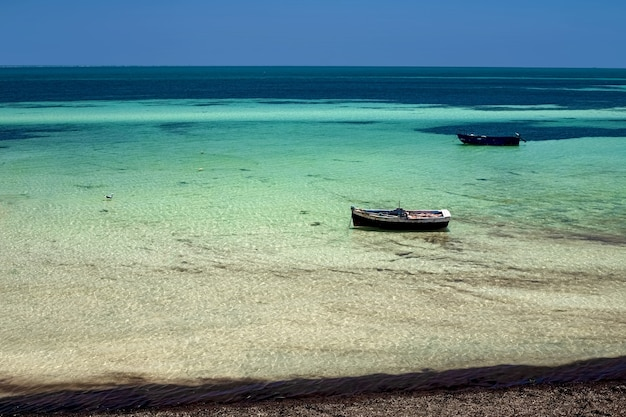 Wonderful views of the mediterranean coast sea with a fishing boat