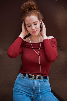 Wonderful young woman listening to music