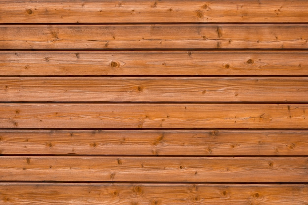 Wood background. horizontal boards with knots