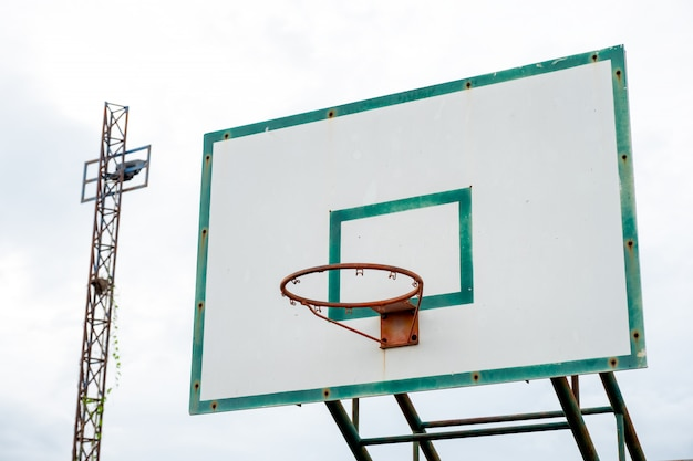 Wood basketball backboard with hoop green frame