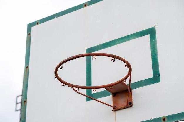 Wood basketball backboard with hoop green frame