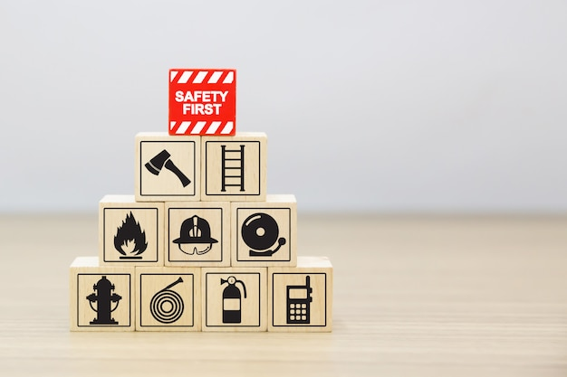 Wood block stacking with fire and safety icons.