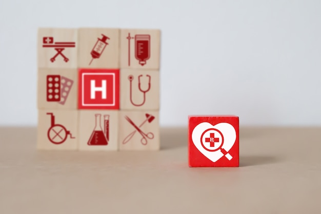 Wood block stacking with medical and health concept.