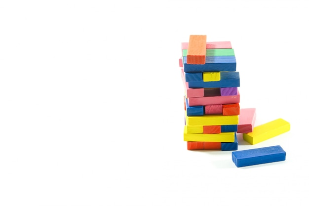 Wood block toy on isolated white.
