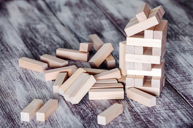 Wood blocks stack game, table concept