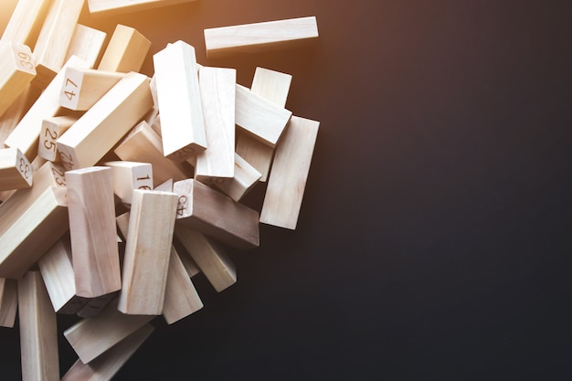 Wood blocks with copy space, brown background with sunshine. human resources, management