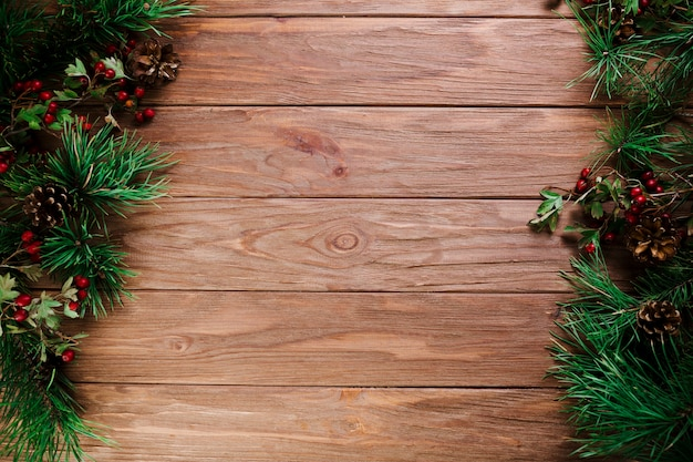 Wood board with christmas branches