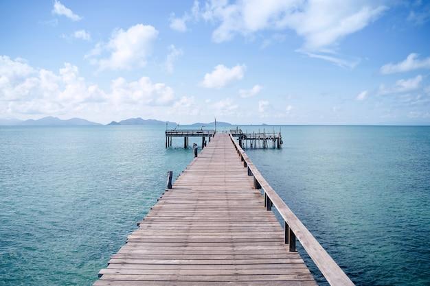 A wood bridge built up into the ocean