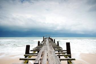 Wood bridge in to the sea