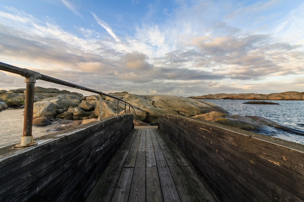 Wood bridge with clouds and sky above