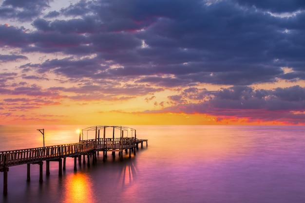 Wood bridge with seascape at twilight time