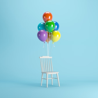 Wood chair with colorful balloons floating on blue background.