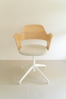 Wood chair with grey fabric seat