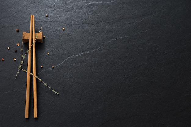 Wood chopsticks on old marble space