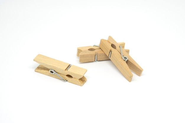 Wood clothes peg or clothespin on white background.