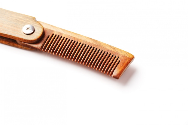 Wood comb made of natural sandalwood for men on white.
