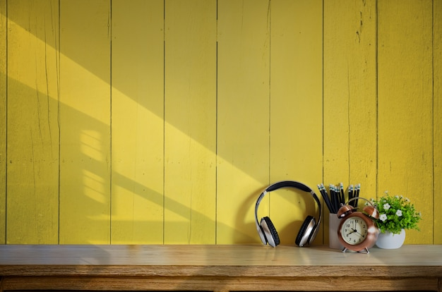Wood desk with headphones and gadget