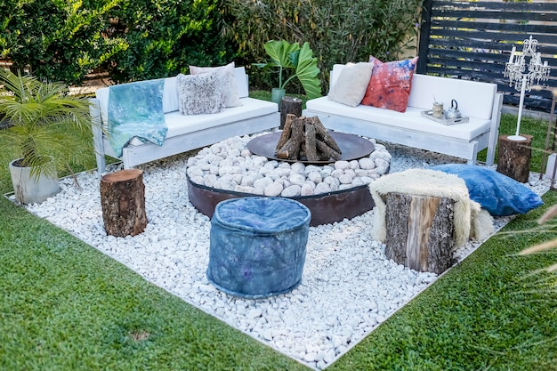Wood fire and stones with benches in the garden