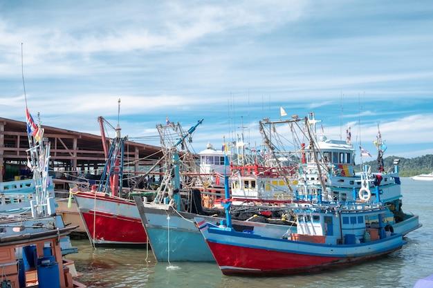 Wood fishing boats moored at wharf