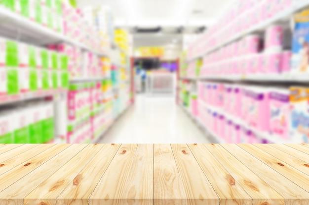 木の床とスーパーマーケットは背景をぼかす