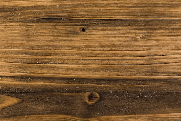 Wood grain surface with knots