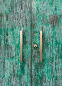 Wood green door with knob and keyhole