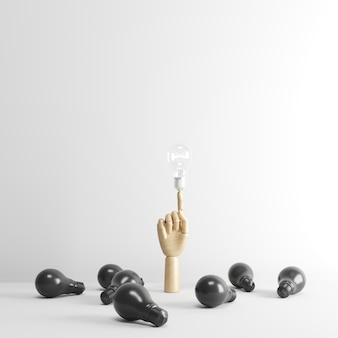 Wood hand finger point to one lighting bulb on floor.