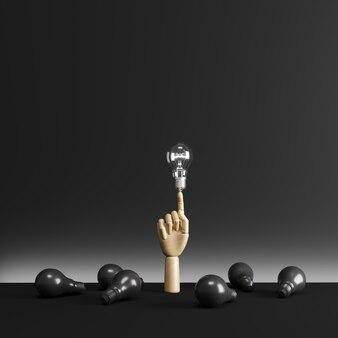 Деревянная рука палец указывает на одну лампочку освещения среди черной лампочки на полу.