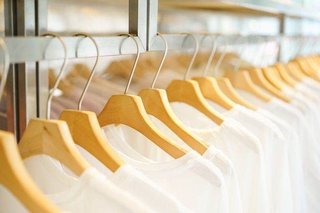 Wood hanger with white t-shirt at woman fashion shop