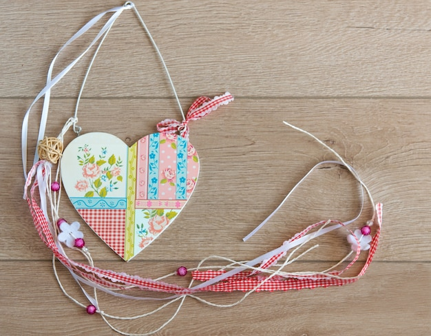 Wood heart with beautiful bright ornament.