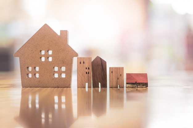Wood house model on wood table, a symbol for construction