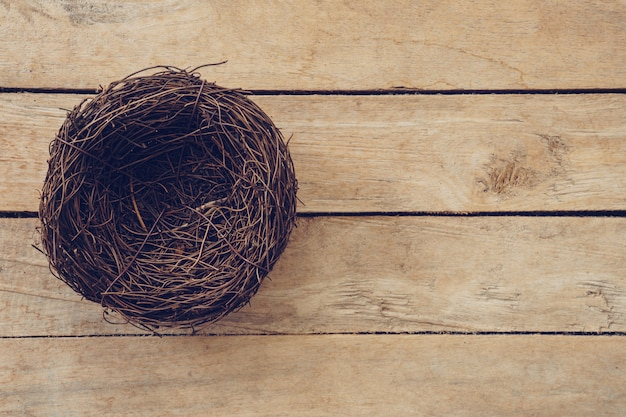 Wood nest on wooden background and texture with copy space.