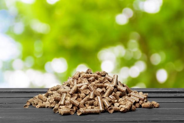 Wood pellets on a green nature. biofuels.