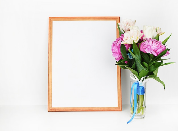 Wood picture frame with decorations.