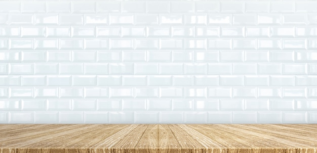 Wood plank table top at white glossy ceramic tile wall background