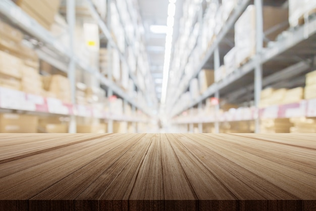 Wood plank table top with warehouse store blur background for product display